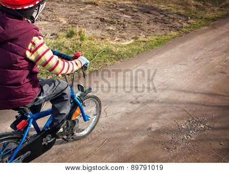 Boy on bike at countryside road