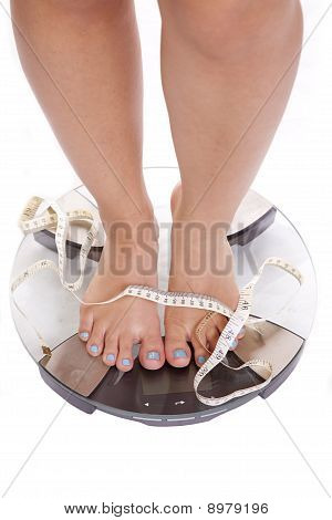 Feet And Legs Tape On Scales