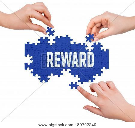 Hands With Puzzle Making Reward Word  Isolated On White