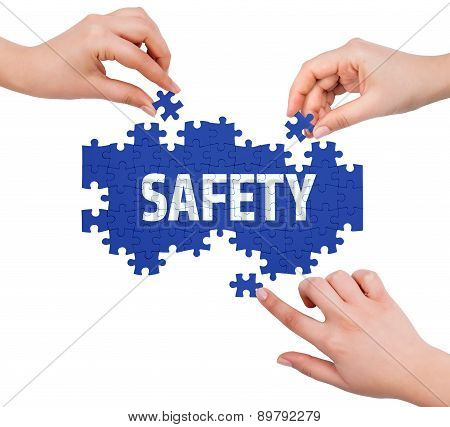 Hands With Puzzle Making Safety Word  Isolated On White
