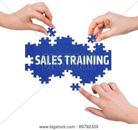 Hands With Puzzle Making Sales Training Word  Isolated On White