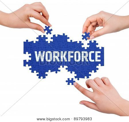 Hands With Puzzle Making Workforce Word  Isolated On White