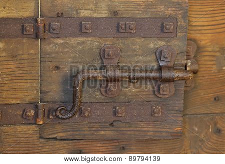 Rusty Lock With Big Deadbolt To Close The Door Of The Medieval Castle