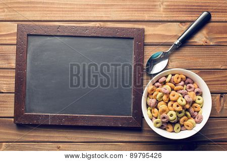 the chalkboard and colorful cereal rings in spoon