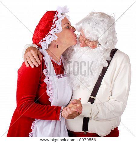 Mrs. Kissing Santa Claus