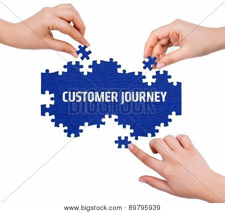 Hands With Puzzle Making Customer Journey Word  Isolated On White