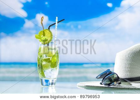 Mojito cocktail with fresh lime at the beach