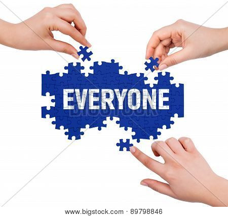 Hands With Puzzle Making Everyone Word  Isolated On White