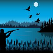 picture of duck-hunting  - The Huntsman on lake shoots at flying duck - JPG