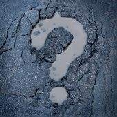 image of road construction  - Road construction concept and city maintenance of infrastructure symbol as broken pavement or asphalt shaped as a question mark pot hole or damaged street as an icon for highway safety questions - JPG