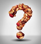 stock photo of mixed nut  - Nut question mark with a mixed assortment of seeds and pecan with walnut brazil nut peanuthazelnut pistachio almond and cashew as a symbol of confusion and allergy to nuts information or food facts icon - JPG