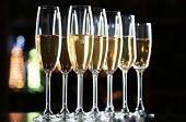 image of champagne glasses  - Glasses of champagne on bar background - JPG