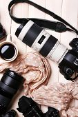 picture of megapixel  - Still life with modern cameras on wooden table - JPG