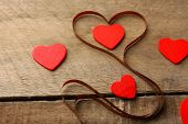stock photo of magnetic tape  - Magnetic tape in shape of heart on wooden background - JPG