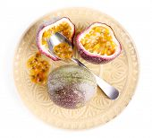 foto of passion fruit  - Passion fruit on plate isolated on white - JPG