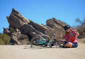 picture of fallen  - Women fallen off her bike while riding at Vasquez Rocks - JPG