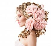 stock photo of perm  - Beauty girl with rose flowers hairstyle isolated on white background - JPG