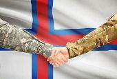 picture of faro  - Soldiers shaking hands with flag on background  - JPG