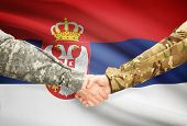 foto of serbia  - Soldiers shaking hands with flag on background  - JPG