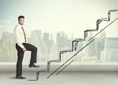 foto of climb up  - Business man climbing up on hand drawn staircase concept on city background - JPG