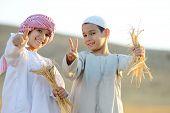 stock photo of muslim kids  - Kids on wheat field - JPG