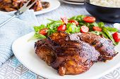 stock photo of bast  - Grilled boneless chicken thighs marinated and basted in a mixture of guava jam shoyu oyster sauce and seasonings - JPG