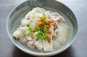 picture of scallion  - Bowl of Vietnamese pho noodle soup with sausage served with onions scallions and cilantro - JPG