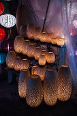 foto of eastern culture  - Straw woven lanterns in old Hoi An town in Vietnam - JPG