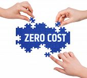 stock photo of zero  - Hands with puzzle making ZERO COST word isolated on white - JPG
