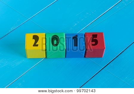 Numeral 2015 on children's colourful cubes or blocks.