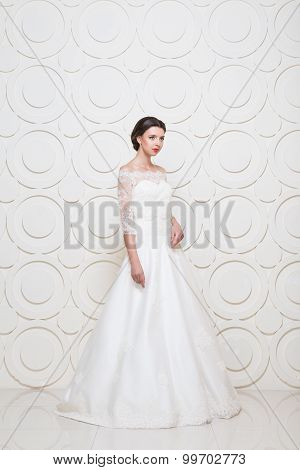 Young beautiful bride dressed wedding dress in high tech interior with circles