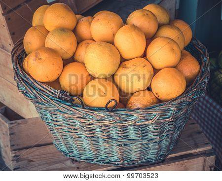 Organic Oranges In A Basket