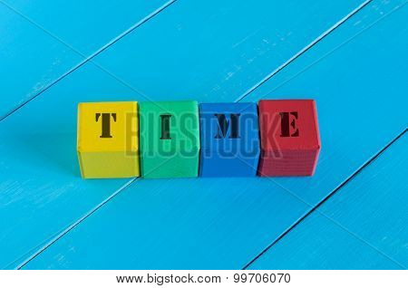 Word Time on children's colourful cubes or blocks