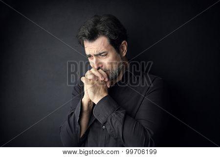 Desperate man praying for something