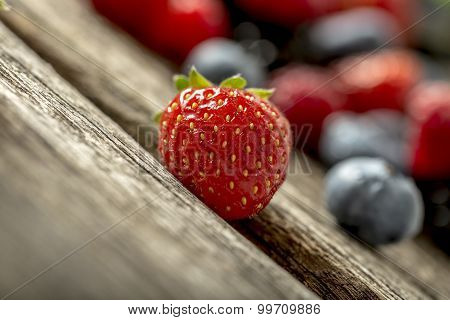 Ripe Red Strawberry On A Rustic Wooden Table