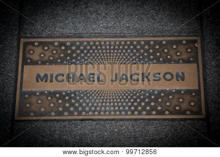 NEW YORK CITY, USA - SEPTEMBER, 2014: Michael Jackson paving slab in front of famous Apollo theatre in Harlem New York City