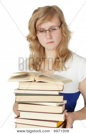 Female Student With Pile Of Books Isolated On White