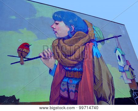 Street art woman and the bird