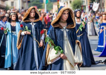 ALBA, ITALY - OCTOBER 05, 2014: Participants in historic noble dresses on Medieval Parade - part of annual White Truffle festival and celebrations taking place each year on October in Alba, Italy.
