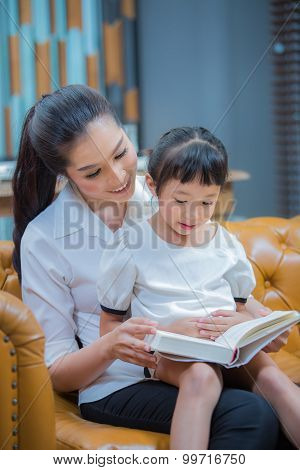 Portrait Of Cute Girl Listening To Her Mother