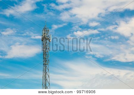 Telecommunication Antenna On Blue Sky With Clouds Background