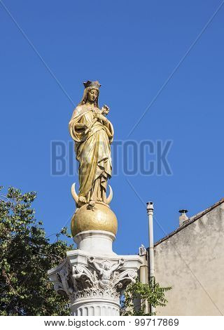 Immaculate Virgin Under Blue Sky