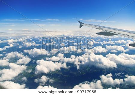 View of beautiful clouds from airplane window