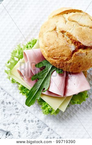Bread roll with ham and lettuce