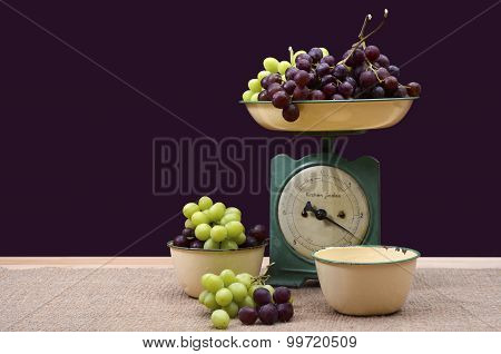 Weighing Grapes On Vintage Scales.