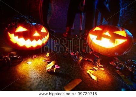 Jack-o-lanterns shining on dance floor