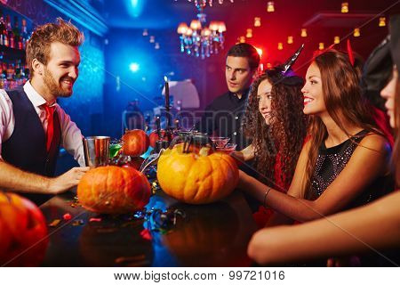 Bartender meeting guests at Halloween night