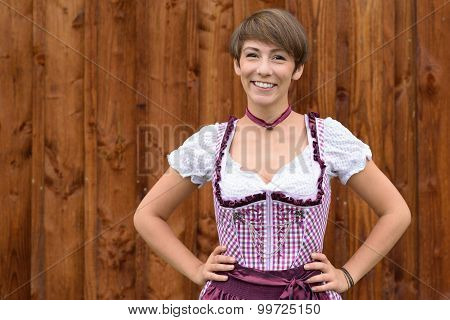Smiling Confident German Lady Wearing A Dirndl