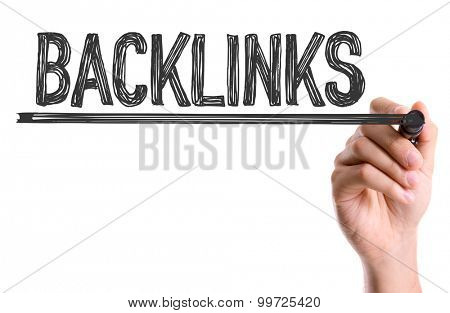 Hand with marker writing the word Backlinks