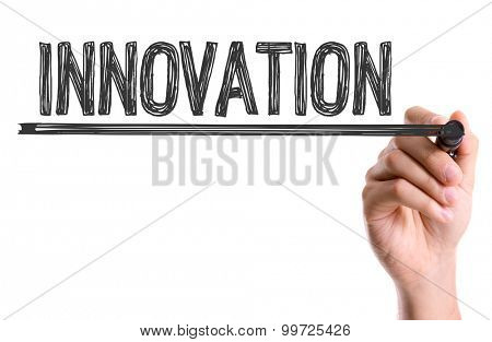 Hand with marker writing the word Innovation